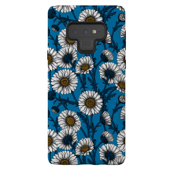 Daisies on blue